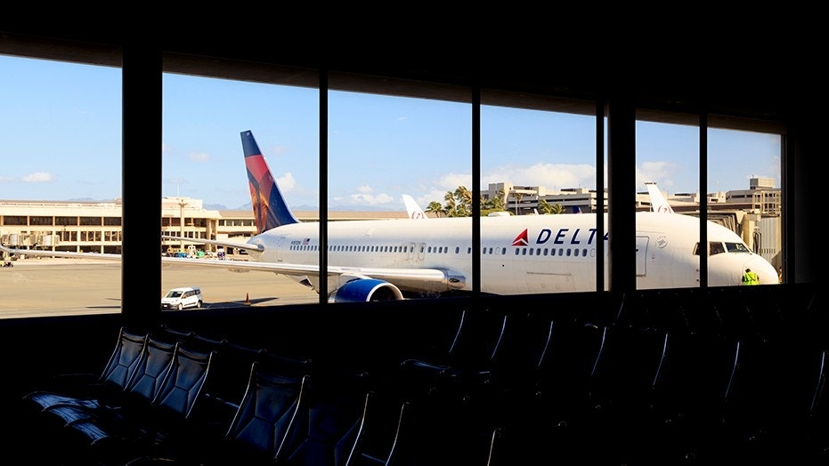 "A Delta passenger spotted baggage handlers ""recklessly"" tossing suitcases and dropping a stroller on the ground."