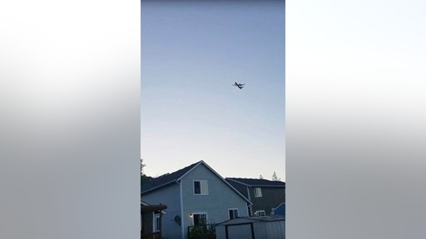 "This photo taken from video provided by Courtney Junka shows the stolen Horizon Air turboprop plane flying over Eatonville, Wash., Friday, Aug. 10, 2018.  Officials say an airline employee stole an empty Horizon Air turboprop plane with no passengers aboard, and took off from Sea-Tac International Airport in Washington state on Friday night before crashing into a small island. The Pierce County Sheriff's Department says preliminary information suggests the crash occurred because the 29-year-old man was ""doing stunts in air or lack of flying skills.""  (Courtney Junka via AP)"