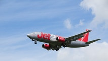 Jersey, U.K. - June 7, 2014: Jet2 a British budget company flying a commercial Boeing 737-300 jet, a nationwide airliner, landing at Jersey airport.
