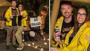 """Devin and Chelsea from Los Angeles spend 13 hours  riding """"Jurasic Park _ the Ride"""" becoming the official record. To celebrate, Devin proposed to Chelsea"""