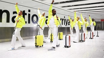 **EMBARGOED UNTIL 00:01 05/09/18 - FREE FOR EDITORIAL USE ***FREDDIE FOR TAKE-OFF! British Airways and Heathrow baggage handlers perform tributes to one-time Heathrow baggage handler Freddie Mercury for the Queen legend's September 5th birthday celebrations at Heathrow T5. The baggage handlers have been taking professional choreography lessons learning a full routine to 'I Want To Break Free'  as part of a special celebration ahead of the release of BOHEMIAN RHAPSODY, the new Queen movie released on October 24th.