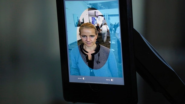 A VeriScan facial recognition tablet takes a photo of a passenger boarding an international flight during a press event announcing ithe next phase of  CBP's use of biometrics at Dulles International Airport in Dulles, Va., Sept. 6, 2018. U.S. Customs and Border Protection Photo by Glenn Fawcett