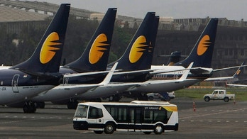 FILE - In this Sept. 9, 2009 file photo, Jet Airways aircrafts sit on the tarmac at the Santacruz domestic airport terminal in Mumbai, India. A Jet Airways flight returned to Mumbai, India's financial capital, on Thursday, Sept. 20, 2018, after dozens of passengers complained of ear pain and nose bleeding due to the loss in cabin pressure. (AP Photo/Rajanish Kakade, File)