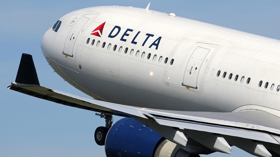 The 23-year-old woman says Delta's crew also served the man up to as many as eight alcoholic drinks over the course of two hours.