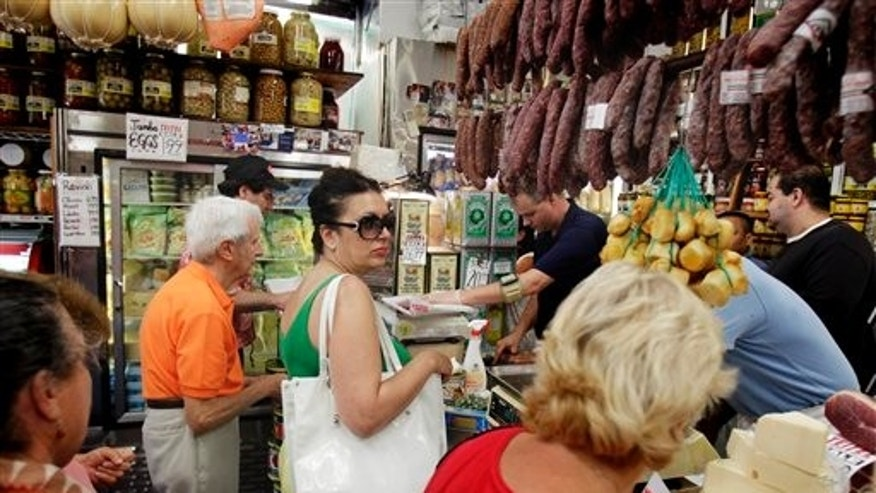 "This Wednesday, Aug. 24, 2011 photo shows shoppers as the wait in line at Teitel Brothers in the Belmont section of the Bronx borough of New York. While Little Italy in downtown Manhattan has shrunk to barely a block and a half, what some call the ""Real Little Italy"" in the Belmont section of the Bronx is thriving, and it's as old-school as ever.  (AP Photo/Seth Wenig)"