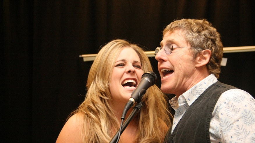 Roger Daltrey of The Who sings along with a Rock 'N Roll Fantasy Camp student. Staffed with major rock stars and experienced counselors, musicians of all experience levels are welcomed to attend and unleash their hidden rock star potential.