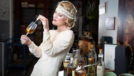 Sports presenter Caroline Henderson wearing 20's costume in the cellars of Gleneagles Hotel to promote the hotel's 90th anniversary Whisky Blending Experience package. More info from Kate Newton on + 44 1764 662231