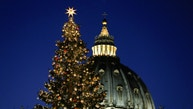 The Vatican Christmas tree is lit up during a ceremony in Saint Peter's Square at the Vatican December 9, 2016. REUTERS/Alessandro Bianchi - RTSVFGF