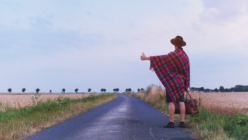 travel by hitchhiking, hitchhiker backpacker on the road