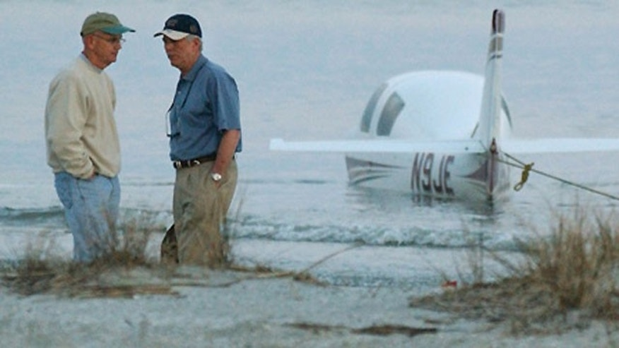 Mar. 15: Two men stand near a plane that crashed along a beach in Hilton Head, S.C.