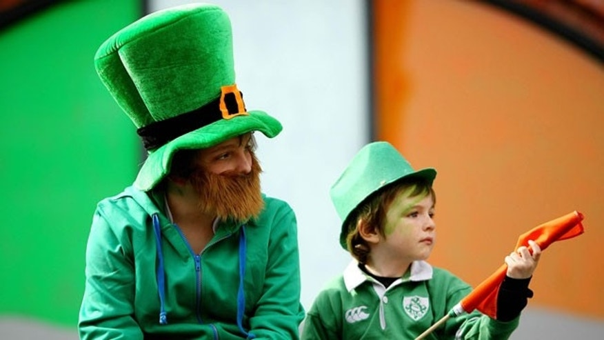 March 17: Children watch the St Patrick's Day parade in Dublin, Ireland.