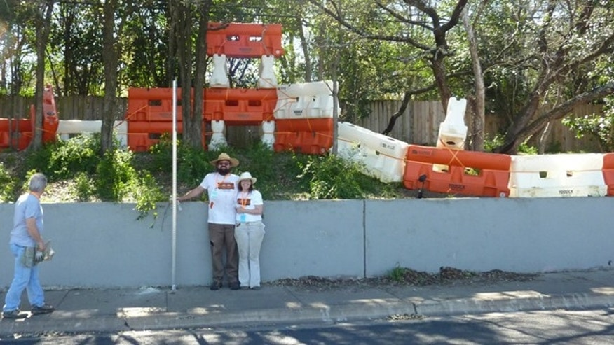 Austin, Texas' cultural arts division is helping sponsor a public installation made up of 50 traffic barriers, an orange-and-white Stonehenge that the project's mastermind is calling the 'Barton Barriers.'