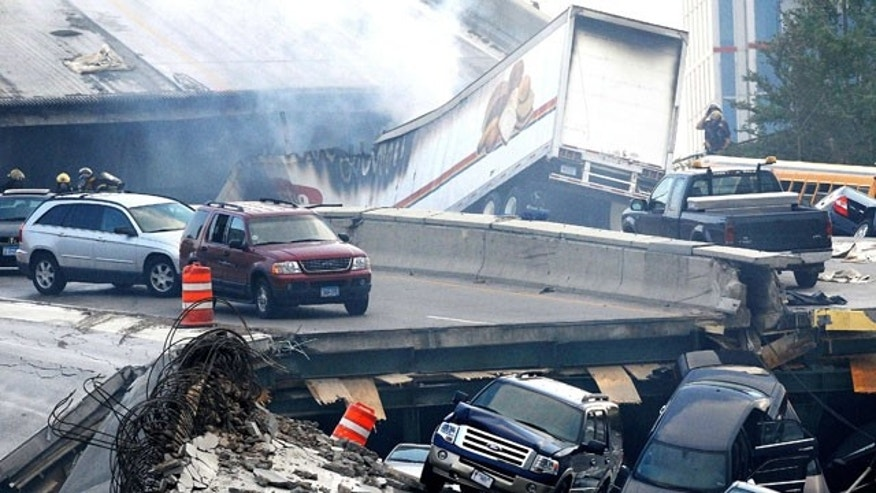 In this Aug. 1, 2007 picture, vehicles are scattered along the broken remains of the Interstate 35W bridge, which stretches between Minneapolis and St. Paul, after it collapsed into the Mississippi River during evening rush hour.