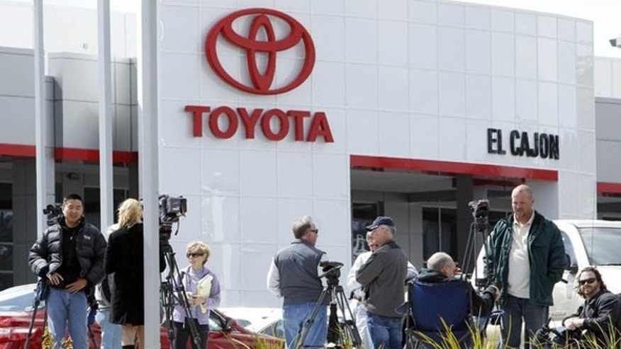March 9: Members of the media gather in front of a Toyota dealership in El Cajon, California (Reuters).