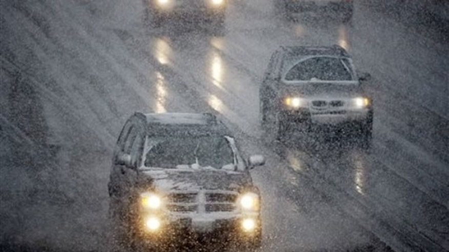 March 23: Motorists drive along Interstate 25 outside downtown Denver as a spring storm packing cold temperatures, high winds and snow envelopes Colorado's mountain and Front Range communities (AP).