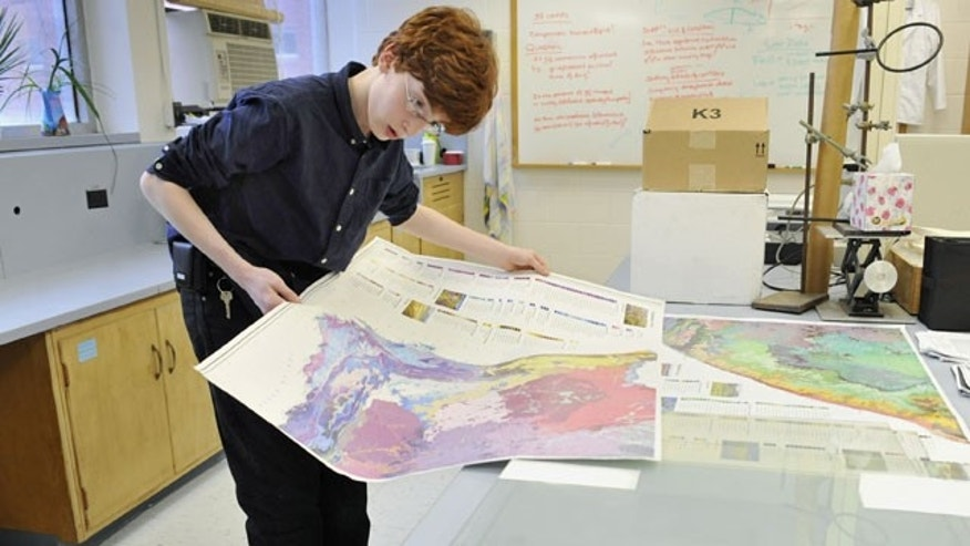 March 23: Colin Carlson, 13, looks at a map of South Africa while on campus at the University of Connecticut in Storrs, Conn.