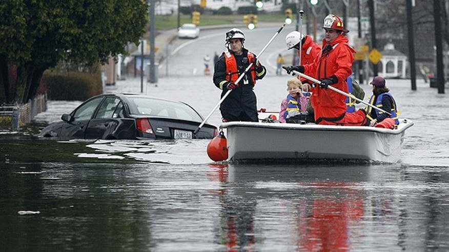 Mar. 30: West Warwick, R.I., firefighters evacuate residents from their flooded houses near the Pawtuxet River.