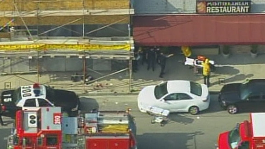 April 3: Police cars and ambulances surround the scene of a deadly restaurant shooting in North Hollywood. (MyFoxLA.com)