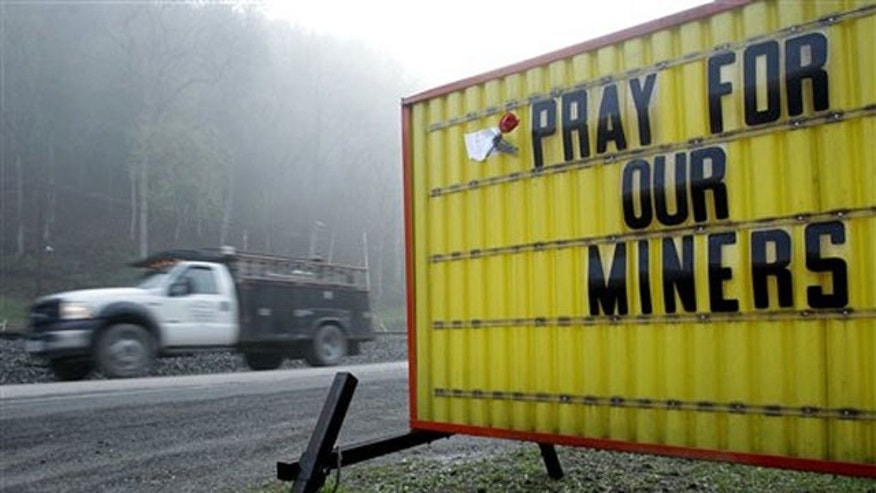 April 6: A sign expressing hope for coal miners is erected after deadly West Virginia explosion.
