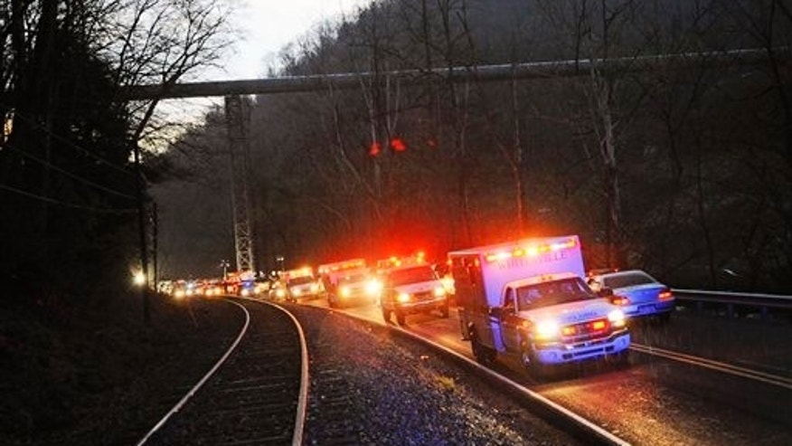 April 5, 2010: Emergency vehicles leave the entrance to Massey Energy's Upper Big Branch Coal Mine in Montcoal, W.Va. after an explosion at the underground coal mine.