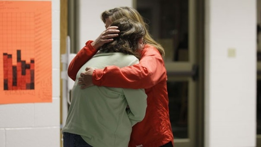 April 10: A woman is embraced by a Red Cross worker as she reacts to the news that rescue workers located the four missing bodies deep in a West Virginia coal mine. (AP)