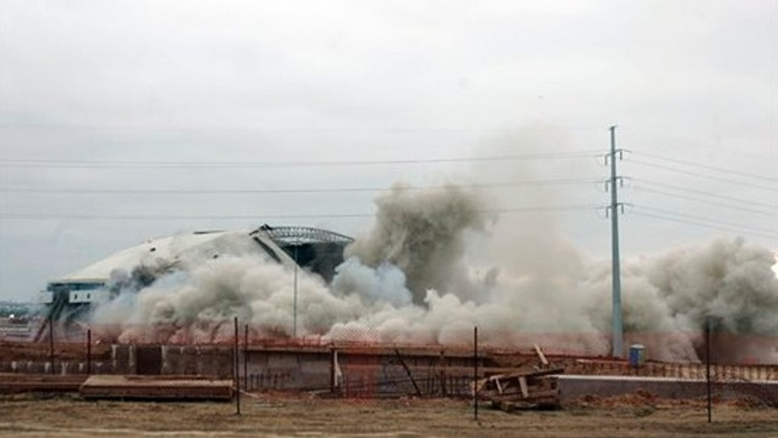 Texas Stadium is imploded Sunday, April 11, 2010 in Irving, Texas. (AP Photo/Mike Fuentes)