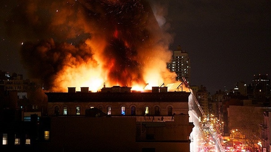 Apr. 12: Firefighters attempt to put out a large blaze near 285 Grand Street in New York City.