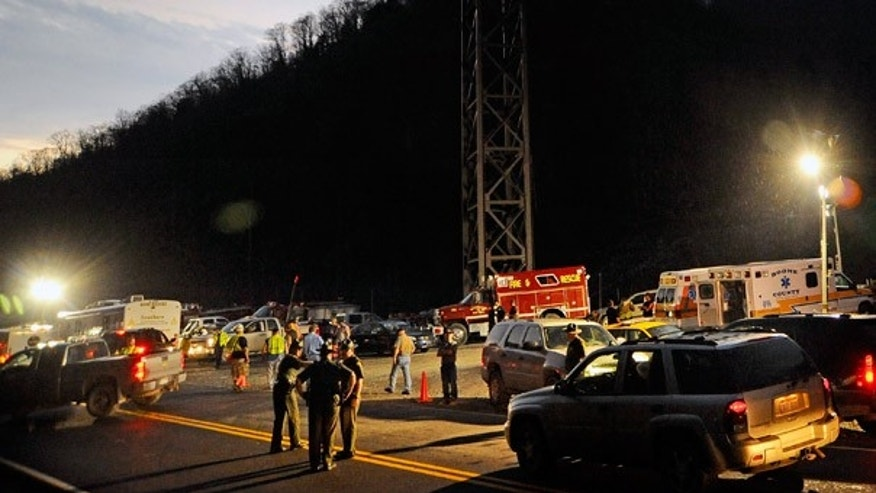 Apr. 4:  West Virginia State Police direct traffic at the entrance to Massey Energy's Upper Big Branch Coal Mine in Montcoal.