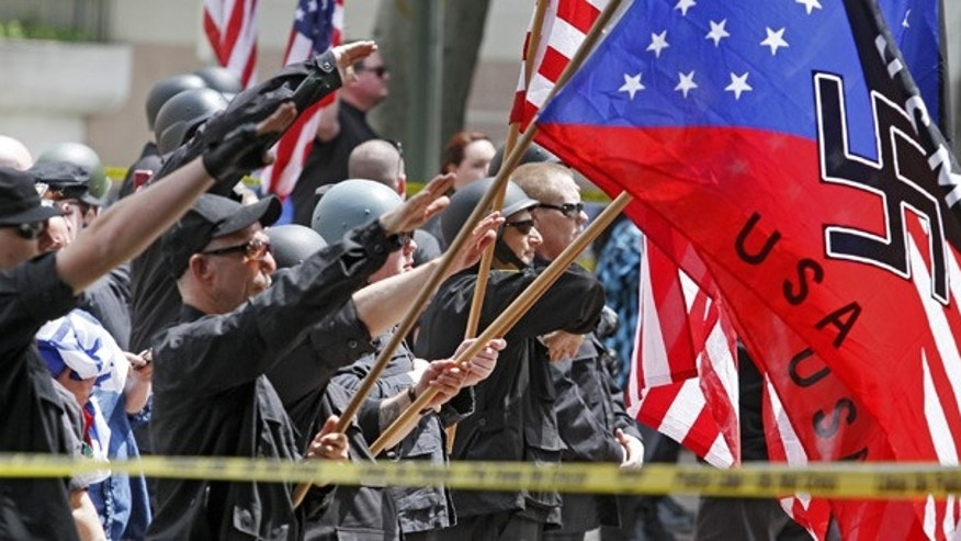 Apr. 17: White supremacists salute American flags and banners with swastikas at Los Angeles City Hall.