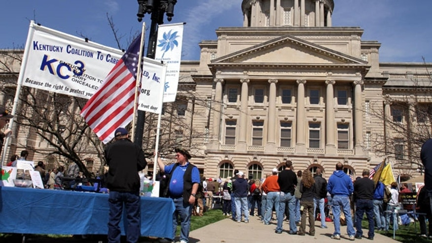 March 27: People listen to speakers near the Kentucky State Capitol in Frankfort, Ky., during a second amendment rally.