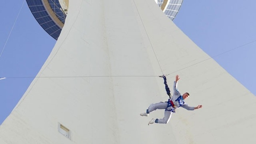 Sr. Master Sgt. Darryl LeBouef jumps from the 108th floor of the Stratosphere Casino, Hotel and Tower in Las Vegas, Nevada, Tuesday, April 20, 2010, during the Grand Opening of SkyJump Las Vegas. LeBouef's 855-ft leap officially set a Guinness World Record for highest commercial decelerated descent.