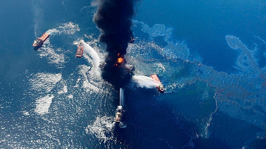 Apr. 21: An oil slick is seen as the Deepwater Horizon oil rig burns in the Gulf of Mexico.