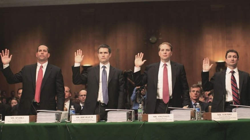 From left: Daniel Sparks, former partner, Head of Mortgages Department; Michael J. Swenson, managing director, Structured Products Group Trading; Joshua S. Birnbaum, former managing director, Structured Products Group Trading; Fabrice Tourre, Executive Director, Structured Products Group Trading; are sworn in on Capitol Hill in Washington, Tuesday, April 27, 2010, prior to testifying before the Senate Investigations subcommittee hearing on Wall Street investment banks and the financial crisis.