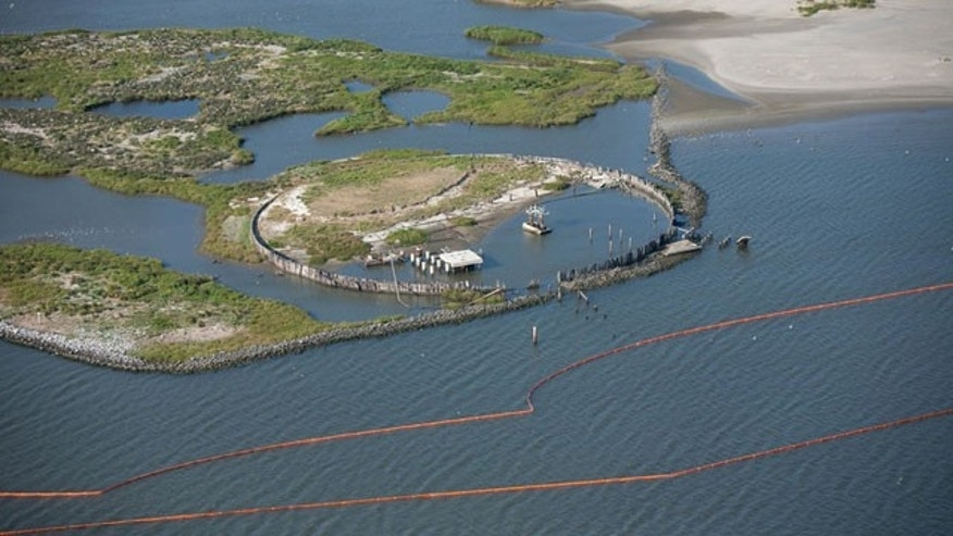 This image provided by the U.S. Coast Guard shows a containment boom staged at the Breton National Wildlife Refuge, Thursday, April 29, 2010. The spill _ a slick more than 130 miles long and 70 miles wide _ threatens hundreds of species of wildlife, including birds, dolphins and the fish, shrimp, oysters and crabs that make the Gulf Coast one of the nation's most abundant sources of seafood.