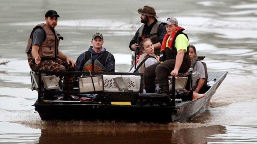 May 2: Evacuated residents are brought across flood waters in Nashville, Tenn.