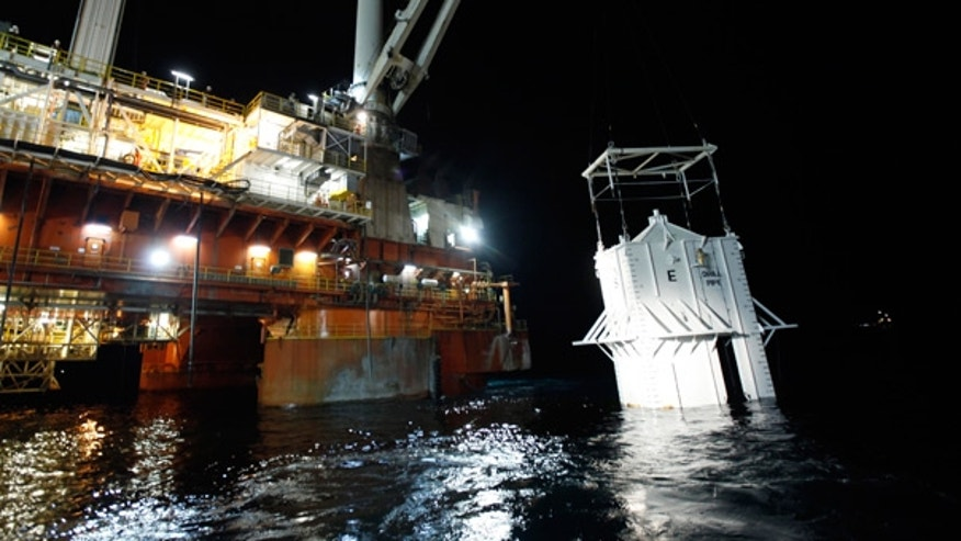 May 6: The oil containment box is lowered into the Gulf at the site of the Deepwater Horizon rig collapse.
