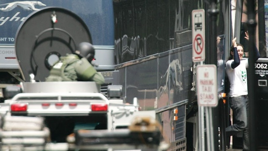 May 6: A hostage, right, is released during a bomb threat aboard a bus which cleared much of downtown Portsmouth, N.H.