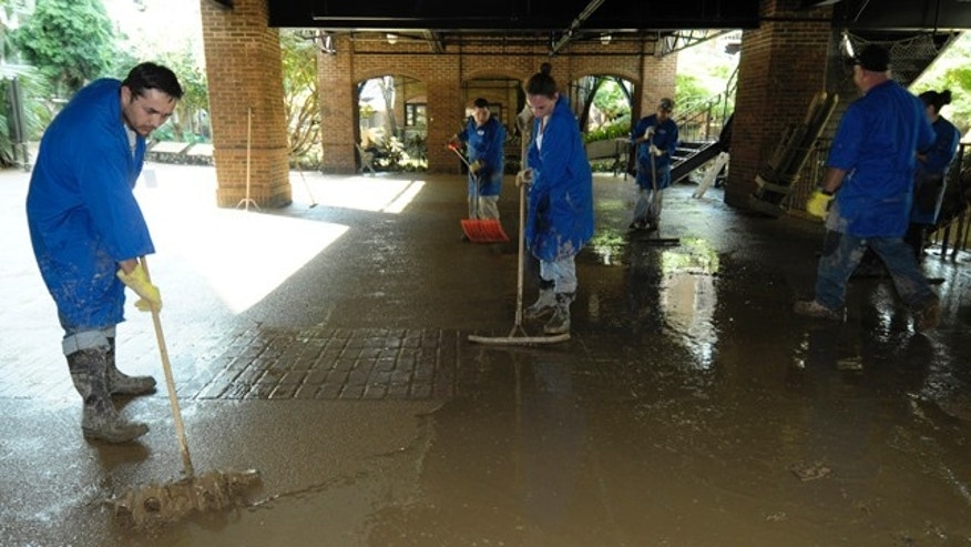 Workers at the Gaylord Opryland Hotel in Nashville, Tenn., clean up after massive flooding left the resort under 10 feet of water.