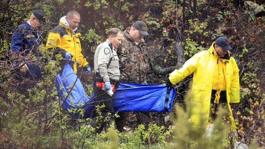 May 11: Investigators with the Weber County Sheriff's Office carry a blue bag down a mountain trail near the Powder Mountain Ski Resort in Eden, Utah following an all-day search for a missing 4-year-old boy from the nearby town of Layton.