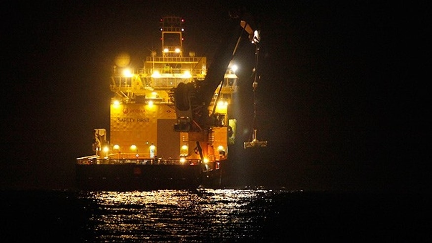 May 11: A ship lowers the top hat device at the site of the Deepwater Horizon oil spill in the Gulf.