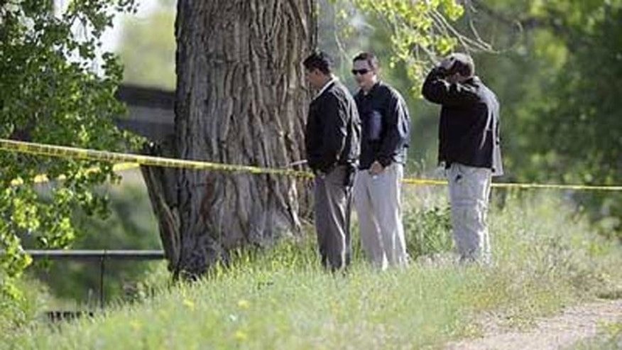 May 19: Police investigate the scene where a body was found in west Greeley, Colo.