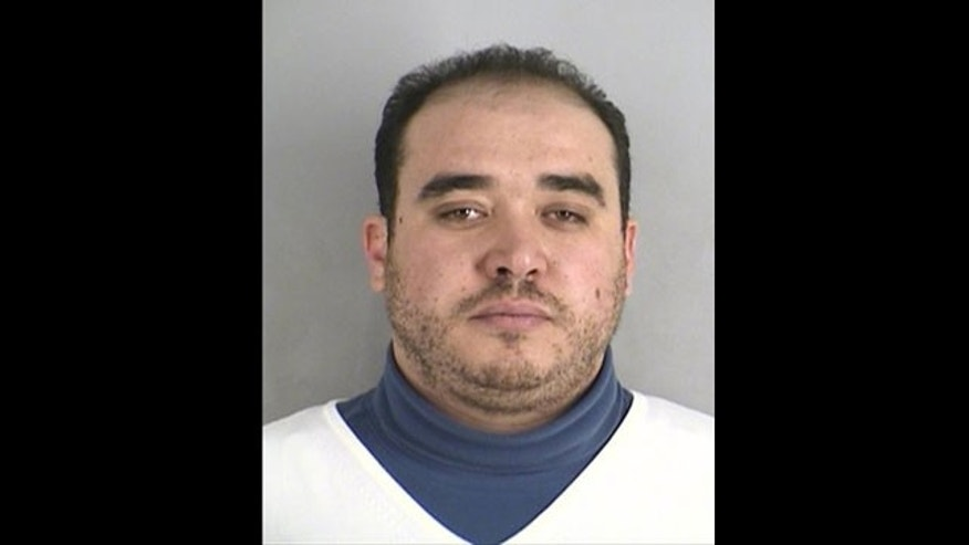 Khalid Ouazzani, a Kansas City auto parts dealer who admitted swearing allegiance to Al Qaeda.