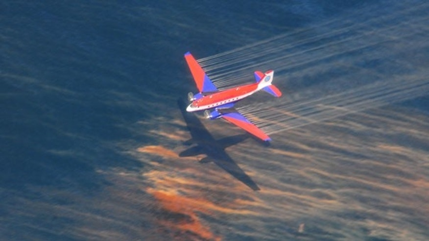 May 5: The crew of a Basler BT-67 fixed wing aircraft releases dispersant over an oil discharge off the shore of Louisiana.