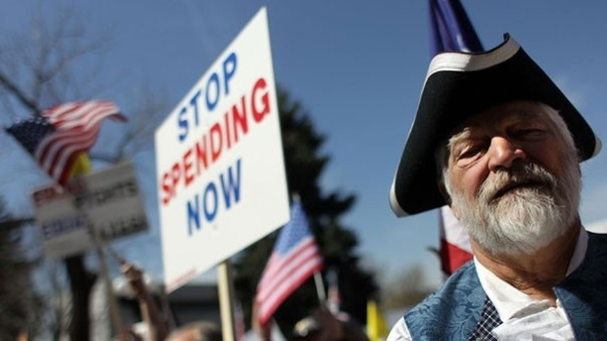 Tea Party demonstrators organize during a Tax Day protest in Denver.