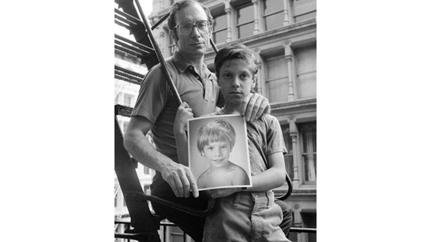 In this 1985 file photo, Stanly Patz, left, holds a photo of his missing son Etan, as he poses for a photo with his other son Ari, at their home in New York.