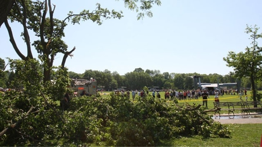 May 31: As broken branches lie in the foreground, people look at a Marine MV-22 Osprey in Clove Lakes Park in the Staten Island borough of New York.  The aircraft's powerful propellers whipped up a wind that sent branches hurling off a tree and into a crowd of about 150 people watching a Memorial Day demonstration in a park, leaving 10 people with cuts and other minor injuries. (Ap)