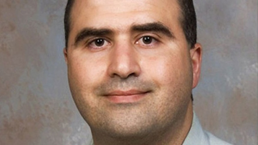 Major Nidal Malik Hasan, the U.S. Army doctor identified by authorities as the suspect in a mass shooting at the U.S. Army post in Fort Hood, Texas, is seen in this undated handout photo. (Reuters)