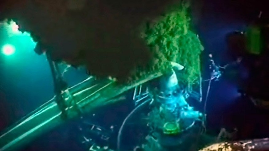 June 2: Underwater robots and other equipment swarm the blowout preventer, bottom left, as oil rises at the site of the Deepwater Horizon spill.