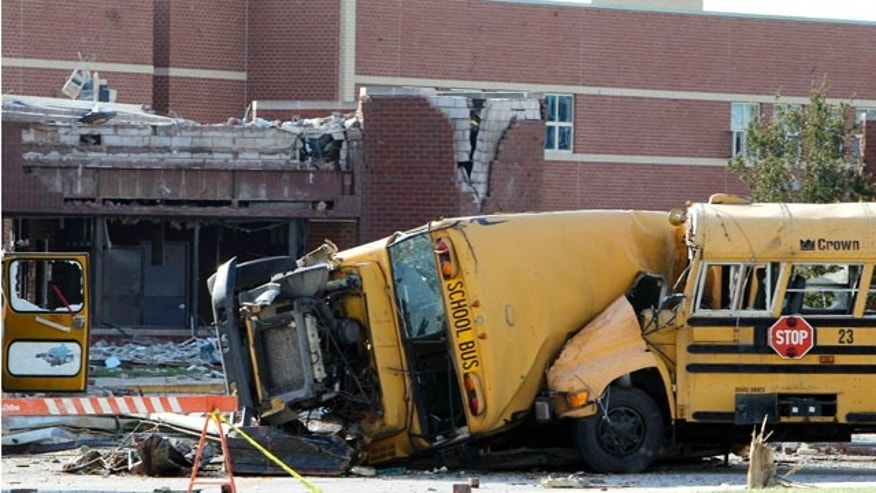June 6: School buses are shown after being tossed by a tornado in the parking lot of damaged Lake High School in Lake Township, Ohio.