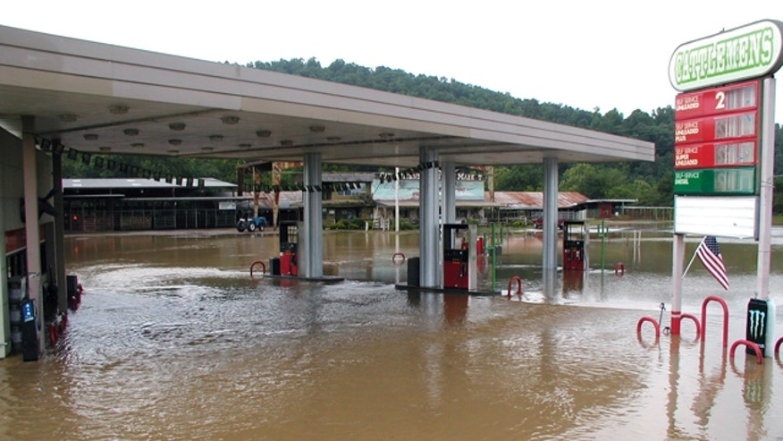 June 11, 2010: A convenience store is flooded by the Caddo River in Glenwood, Ark., part of deadly flash floods that swamped nearby campgrounds.